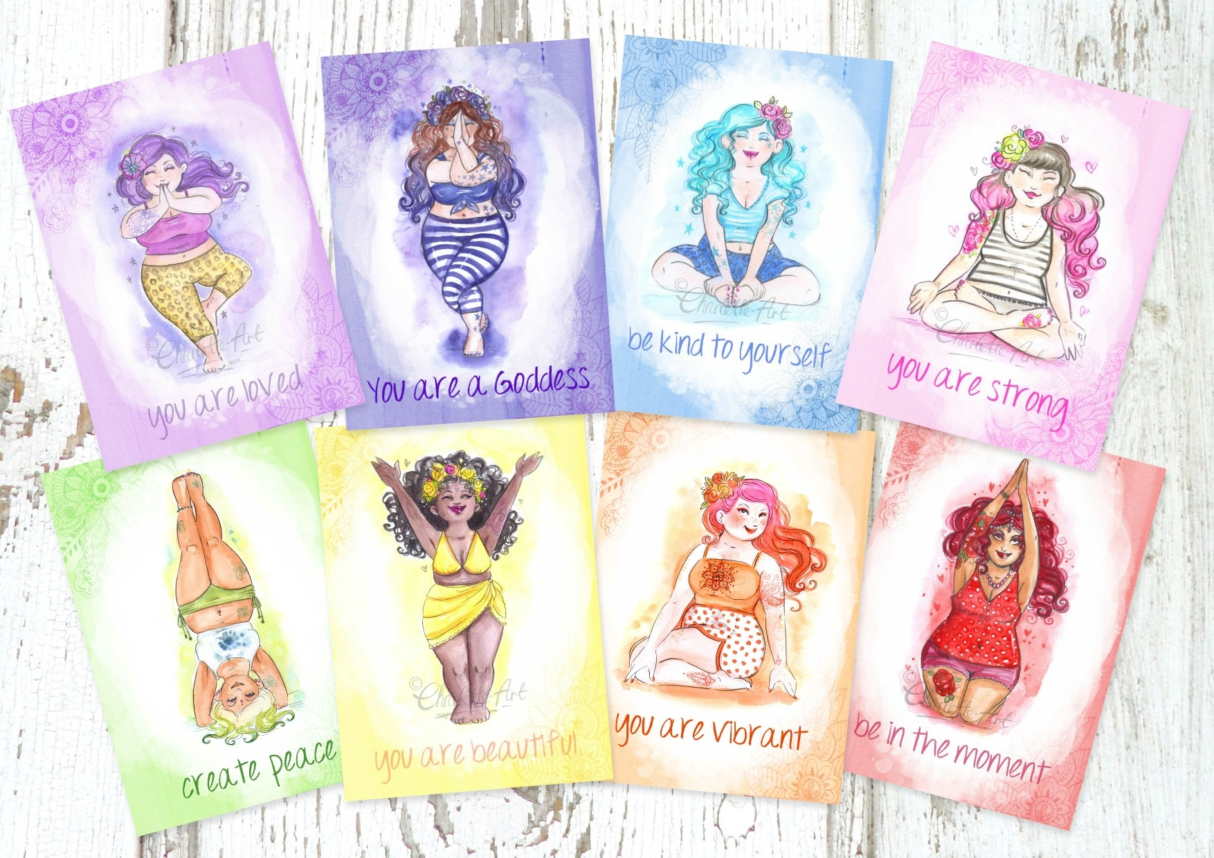 A set of 8 postcards featurings Charlottes paintings of women doing yoga, each one is a different colour of the rainbow.